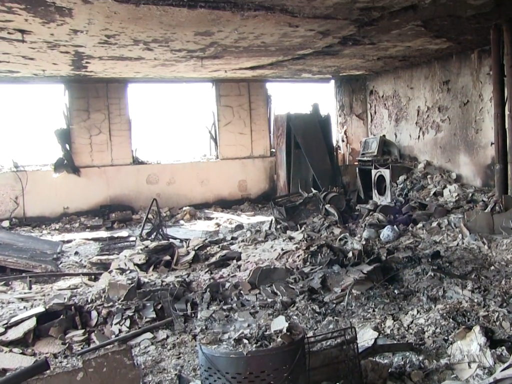 Inside burned remains of Grenfell Tower